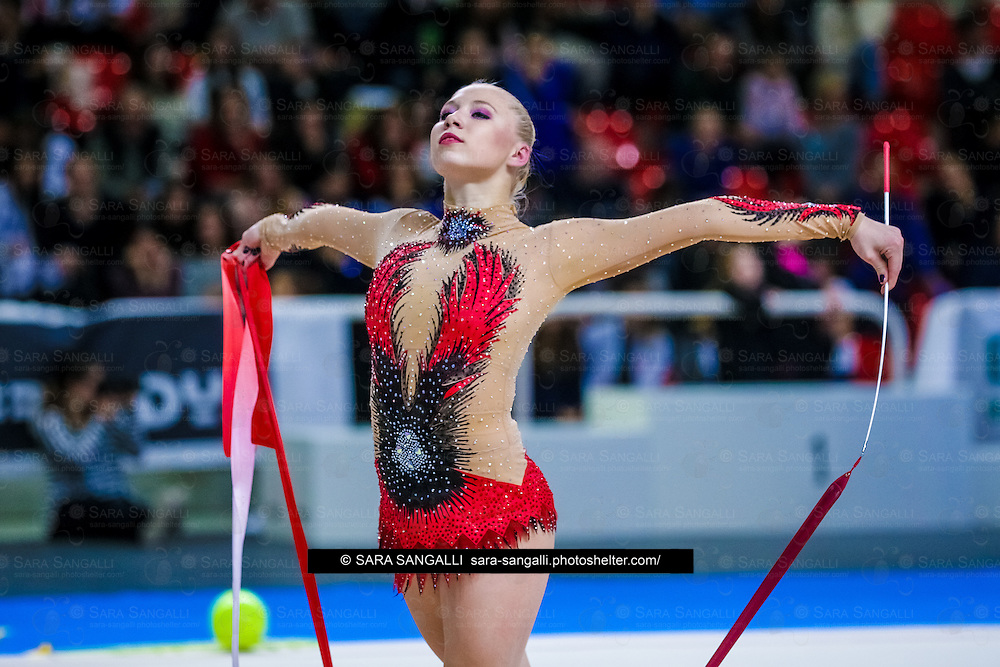 PADUA, ITALY - NOVEMBER 12 2016: Kseniya Moustafaeva of Fabriano performs with ribbon at the italian national rhythmic gymnastic championship. Her score in the apparatus is 17,450. Her team's score is 101,250 and ended up in second position.<br /> #SerieAdiritmica<br /> #ginnasticaritmica #rhythmicgymnastic #gymnast #sport #sportphotography