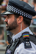 The police join in - the annual London Gay Pride march heads from Oxford Circus to Trafalgar Square.