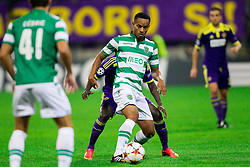 Sintayehu Sallalich of Maribor vs André Carrillo of Sporting during football match between NK Maribor and Sporting Lisbon (POR) in Group G of Group Stage of UEFA Champions League 2014/15, on September 17, 2014 in Stadium Ljudski vrt, Maribor, Slovenia. Photo by Vid Ponikvar  / Sportida.com