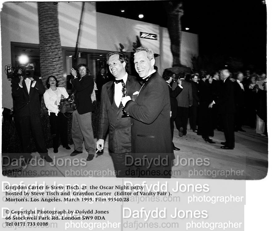 Graydon Carter & Steve Tisch  at  the Oscar Night party hosted by Steve Tisch and  Graydon Carter Editor of Vanity Fair. Morton's. Los Angeles. March 1995. Film 95540/28<br />© Copyright Photograph by Dafydd Jones<br />66 Stockwell Park Rd. London SW9 0DA<br />Tel 0171 733 0108
