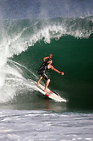 20 June 2006: Surfer surrounded by a wall of water during a South swell reaches the famous surf spot in Newport Beach, CA called The Wedge.  Surfers, boogie boarders, body surfers and crowds gather to watch the powerful waves and the waters take shape into unique sets along the jetty in Orange County, California.