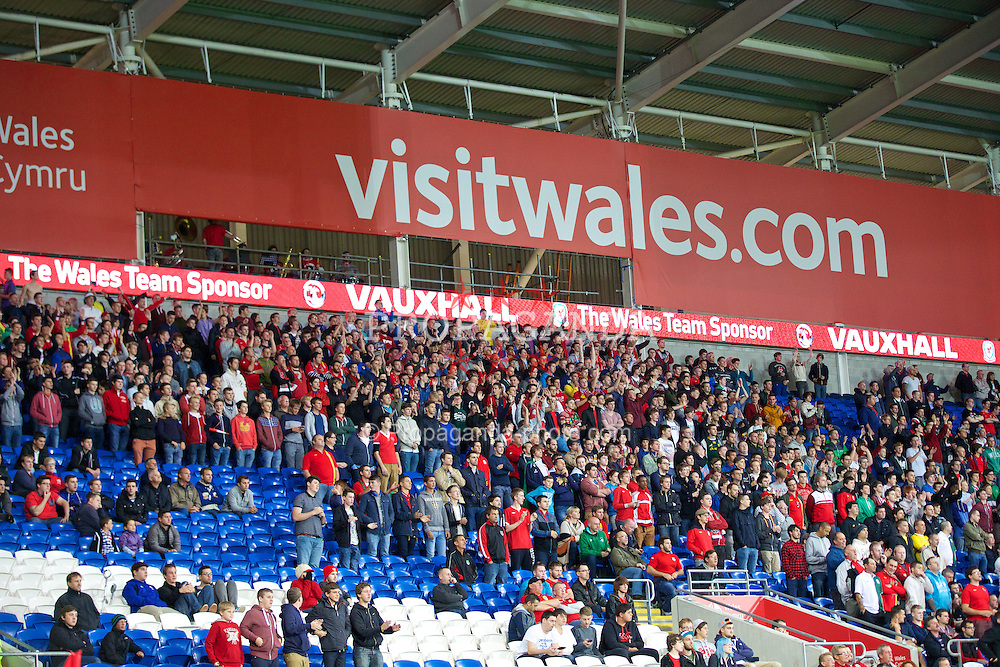 CARDIFF, WALES - Tuesday, September 10, 2013: Wales' supporters during the 2014 FIFA World Cup Brazil Qualifying Group A match against Serbia at the Cardiff CIty Stadium. (Pic by David Rawcliffe/Propaganda)