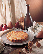 Pears and walnut pie still life with pears, walnuts and bottle