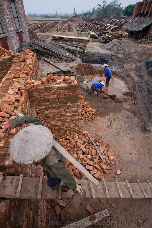 Women work at  a brick factory in Ha Tay province, outside Hanoi, Vietnam.