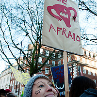 London UK. January 21st 2017.An estimated 100,000 protesters took part in a Women's March from the US Embassy in Grosvenor Square to Trafalgar Square as part of an international campaign on the first full day of Donald Trump's Presidency of the United States. A woman holds a placard with a drawing of female genitalia  and the words 'Be afraid'.