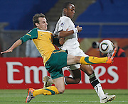 Luke Wilkshire and Andre Ayew. Ghana V Australia. Royal Bafokeng Stadium. Rustenberg. South Africa..Saturday 19th June 2010..Picture by Zute Lightfoot.