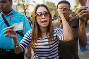"01 FEBRUARY 2014 - BANGKOK, THAILAND: A Thai women screams at anti-government protestors blocking her access to the polls. She wanted to vote and was upset when protestors shut her polling place. Thais went to the polls in a ""snap election"" Sunday called in December after Prime Minister Yingluck Shinawatra dissolved the parliament in the face of large anti-government protests in Bangkok. The anti-government opposition, led by the People's Democratic Reform Committee (PDRC), called for a boycott of the election and threatened to disrupt voting. Many polling places in Bangkok were closed by protestors who blocked access to the polls or distribution of ballots. The result of the election are likely to be contested in the Thai Constitutional Court and may be invalidated because there won't be quorum in the Thai parliament.    PHOTO BY JACK KURTZ"