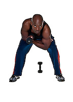 Young Body Builder African American doing excersice in the with a 10 pound weight.