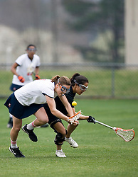 Virginia Cavaliers A Blair Weymouth (2) fights for a loose ball against Princeton.  The Virginia Cavaliers women's lacrosse team defeated the Princeton Tigers 9-7 at Klockner Stadium in Charlottesville, VA on March 24, 2007.