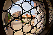 MEISSEN, GERMANY - MAY 22, 2010: View to the inner yard of the Albrechtsburg castle through an old glass window in Meissen, Germany. Filmed with a fish-eye lens.