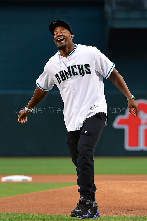 PHOENIX, AZ - APRIL 26:  Arizona Cardinals running back David Johnson laughs after throwing out the ceremonial first pitch prior to the MLB game between the St. Louis Cardinals and Arizona Diamondbacks at Chase Field on April 26, 2016 in Phoenix, Arizona.  (Photo by Jennifer Stewart/Getty Images)