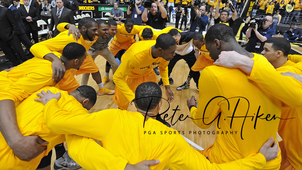 WICHITA, KS - FEBRUARY 22:  Forward Cleanthony Early (C) of the Wichita State Shockers huddles with his teammates before a game against the Drake Bulldogs on February 22, 2014 at Charles Koch Arena in Wichita, Kansas.  (Photo by Peter G. Aiken/Getty Images) *** Local Caption *** Cleanthony Early