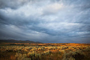 Dramatic clouds over the sagebrush plains: sunrise on the Blacktail Deer Plateau, northern Yellowstone National Park, Wyoming.