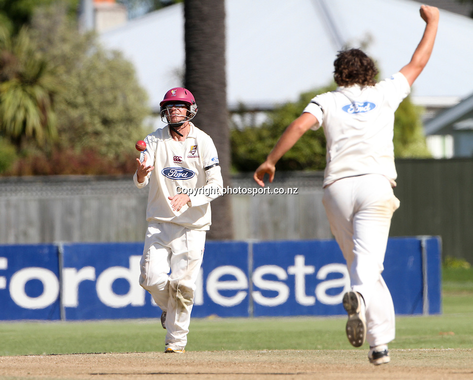 Northern's Brook Hatwell, right, celebrates the wicket of Central's Mathew Sinclair in the teams Plunket Shield cricket match at Nelson Park, Napier, New Zealand. Wednesday 28 March, 2012. Photo: John Cowpland / phtosport.co.nz