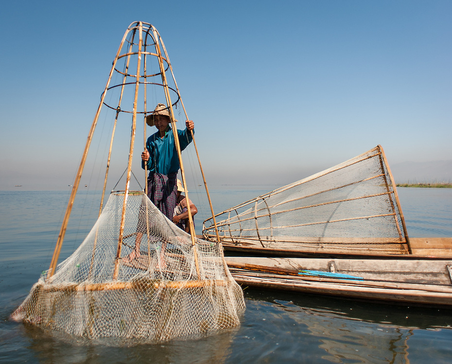 Fisherman with nets on his boat in Inle Lake (Myanmar)