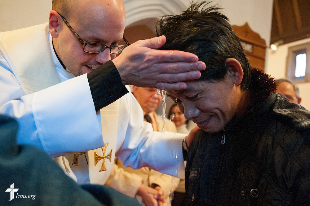 The Rev. Matthew Clark baptizes 21 Nepali immigrants, including Ran Gurung, on Sunday, Jan. 12, 2014, at Ascension Lutheran Church in St. Louis, Mo. LCMS Communications/Erik M. Lunsford