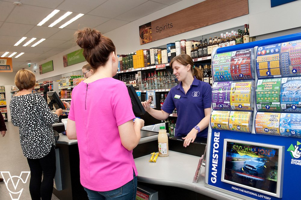 Pictured is Helen Gamwell serving a customer <br /> <br /> Lincolnshire Co-operative food store, Long Bennington, Lincolnshire.<br /> <br /> Date: September 28, 2015