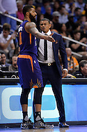 Feb 10, 2016; Phoenix, AZ, USA; Phoenix Suns head coach Earl Watson talks with forward Markieff Morris (11) in the game against the Golden State Warriors at Talking Stick Resort Arena. The Golden State Warriors won 112-104. Mandatory Credit: Jennifer Stewart-USA TODAY Sports