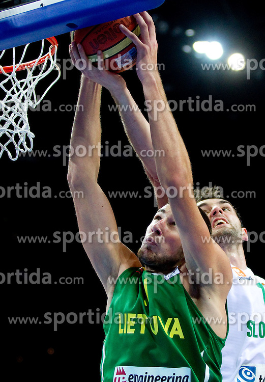 Jonas Valanciunas of Lithuania vs Mirza Begic of Slovenia during basketball game between National basketball teams of Slovenia and Lithuania at of FIBA Europe Eurobasket Lithuania 2011, on September 15, 2011, in Arena Zalgirio, Kaunas, Lithuania. Lithuania defeated Slovenia 80-77.  (Photo by Vid Ponikvar / Sportida)