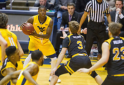 Dec 23, 2016; Morgantown, WV, USA; West Virginia Mountaineers guard Teyvon Myers (0) looks to pass the ball during the first half against the Northern Kentucky Norse at WVU Coliseum. Mandatory Credit: Ben Queen-USA TODAY Sports