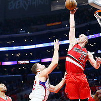 12 December 2016: LA Clippers forward Blake Griffin (32) is blocked by Portland Trail Blazers center Mason Plumlee (24) during the LA Clippers 121-120 victory over the Portland Trail Blazers, at the Staples Center, Los Angeles, California, USA.