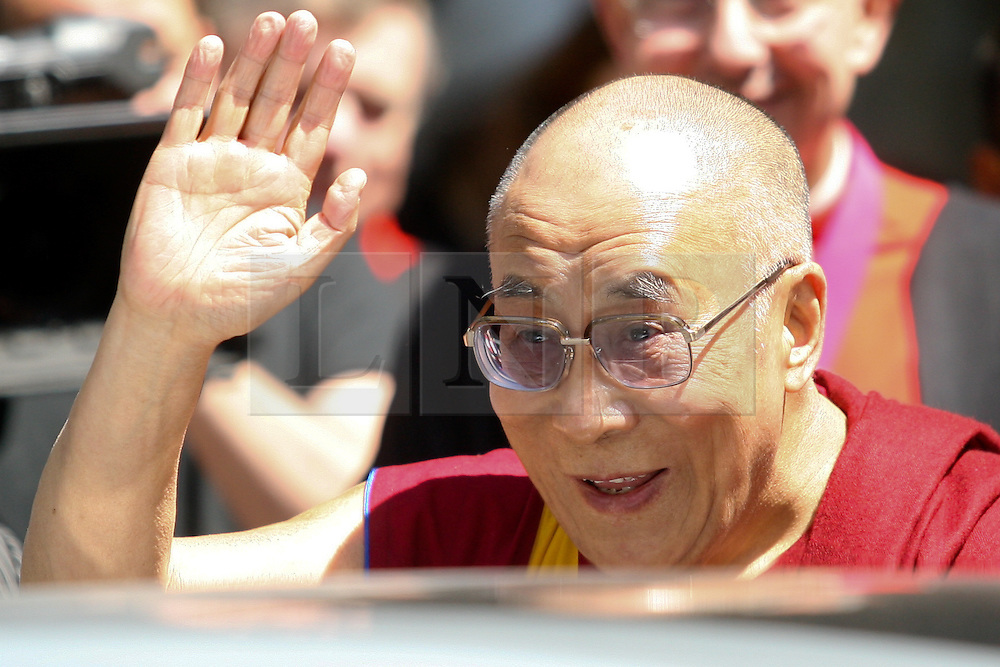 © Licensed to London News Pictures. 20/06/2012. London, UK. His Holiness the Dalai Lama leaves Westminster Abbey after giving a speech . The Dalai Lama is on a tour of the UK .Photo credit : Thomas Campean/LNP
