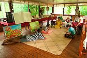 Bulou and Tui Talili with guests at Bulou's Eco Lodge, Navala Village, Viti Levu Island, Fiji.
