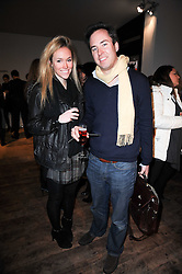 JAMIE MURRAY-WELLS and EVY LANDON at the ISSA show as part of London Fashion Week 2010 held at Somerset House, The Strand, London on 23rd February 2010.