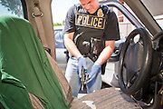 21 SEPTEMBER 2010 - PHOENIX, AZ:  Phoenix detective Dave Dodd (CQ) clears a .22 revolver after finding it on the floor in a truck driven by David Saunders after they arrested Saunders Tuesday. Crime has steadily dropped in Phoenix over the past few years, in line with national trends. The latest number released this month showed Phoenix reported fewer 2010 homicides, rapes, robberies, thefts - in addition to other major crimes -- compared with the same time period the previous year. Detectives in the Phoenix police department's Major Offender Unit make several arrests every day.  PHOTO BY JACK KURTZ
