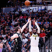 01 April 2018: Denver Nuggets forward Paul Millsap (4) takes a jump shot over Milwaukee Bucks center Tyler Zeller (44) during the Denver Nuggets 128-125 victory over the Milwaukee Bucks, at the Pepsi Center, Denver, Colorado, USA.