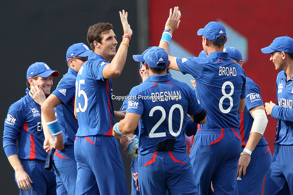 Steven Finn of England celebrates the wicket of Brendon McCullum during the ICC World Twenty20 Super 8s match between England and New Zealand held at the  Pallekele Stadium in Kandy, Sri Lanka on the 29th September 2012<br /> <br /> Photo byRon Gaunt/SPORTZPICS/PHOTOSPORT