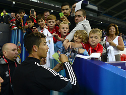 Real Madrid's Cristiano Ronaldo signs autographs - Photo mandatory by-line: Joe Meredith/JMP - Mobile: 07966 386802 11/08/2014 - SPORT - FOOTBALL - Cardiff - Cardiff City Stadium - Real Madrid v Sevilla - UEFA Super Cup - Press Conference and Open Training session