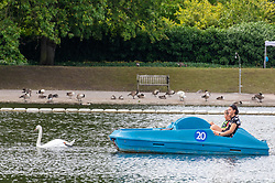 © Licensed to London News Pictures. 17/07/2020. London, UK. A family enjoy the sunshine in a pedalo on the Serpentine in Hyde Park as weather forecasters predict 28c for the end to the week with rain on Sunday. As Prime Minister Boris Johnson calls for Britons to return to working in offices to help local service industries and the economic recovery. Photo credit: Alex Lentati/LNP