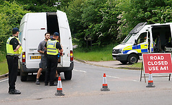 Bilderberg Policy Summit.<br /> A driver is questioned by police after his van was searched, before he was permitted to enter the sealed off Grove hotel complex where the Bilderberg policy summit is being held near Watford, north of London,<br /> London, United Kingdom<br /> Friday, 7th June 2013<br /> Picture by Max Nash / i-Images