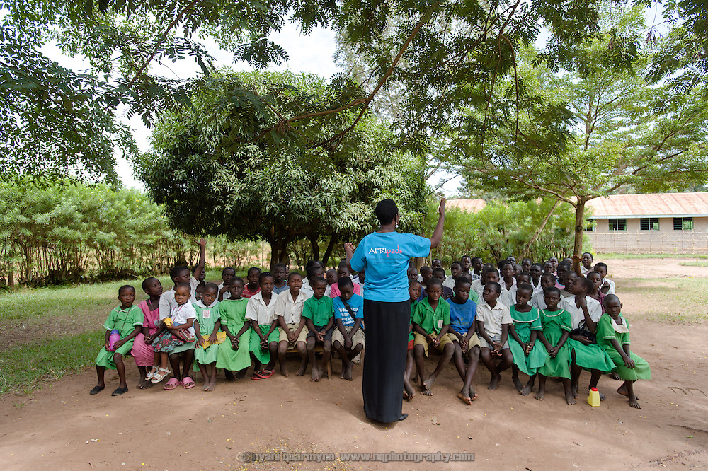 Lovisa Wankya, a teacher and an Afripads dealer, speaking to students at Achilet Primary School near Tororo in Eastern Uganda about menstrual hygiene and the correct use of Afripads on 1 August 2014. Afripads are reusable fibre sanitary pads that are having a revolutionary impact on menstrual hygiene management, particularly amongst girls and women who cannot afford expesive disposable pads, and who previously had to use rags, cotton wool or toilet paper.