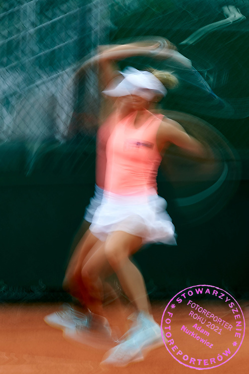 Paris, France - 2017 June 02: Magda Linette from Poland plays a forehand while her women's double match second round during tennis Grand Slam tournament The French Open 2017 (also called Roland Garros) at Stade Roland Garros on June 02, 2017 in Paris, France.<br /> <br /> Mandatory credit:<br /> Photo by &copy; Adam Nurkiewicz<br /> <br /> Adam Nurkiewicz declares that he has no rights to the image of people at the photographs of his authorship.<br /> <br /> Picture also available in RAW (NEF) or TIFF format on special request.<br /> <br /> Any editorial, commercial or promotional use requires written permission from the author of image.