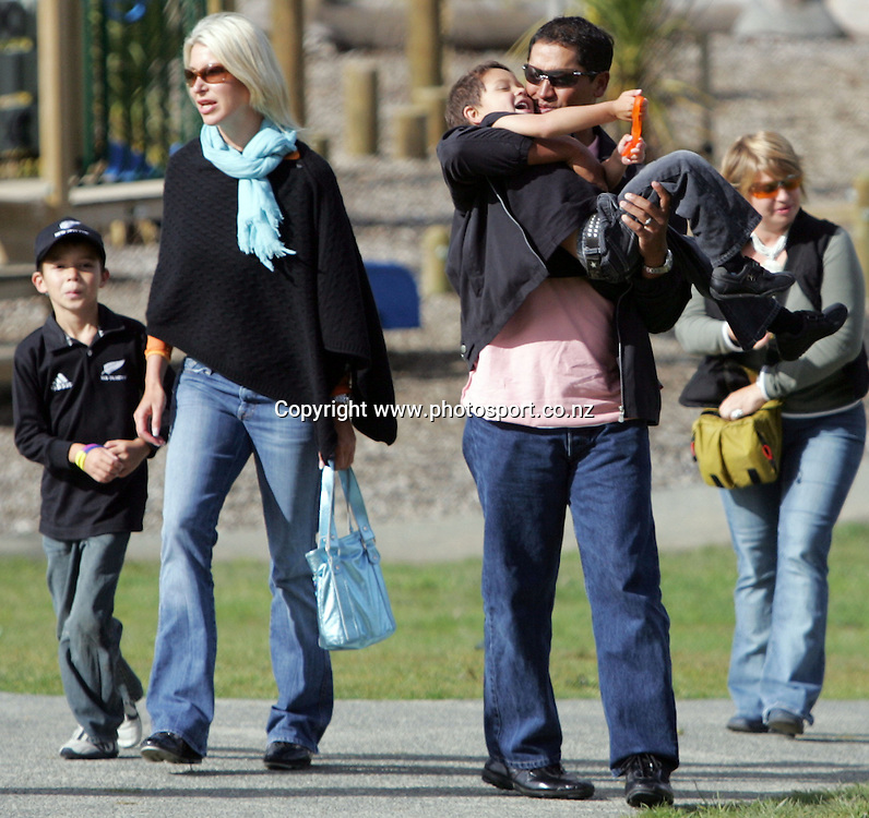 US Golf Open Champion Michael Campbell holds his 4yr old son Jordan during a visit to All Black training with his 6yr old son Thomas (L) and wife Julie (middle) at Waitakere Stadium, Waitakere, Auckland, New Zealand on Thursday 28 July, 2005. Photo: Hannah Johnston/PHOTOSPORT<br /><br /><br /><br />130826