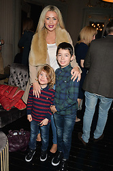 NICOLA McLEAN and her sons (l-r) STRIKER & ROCKY at the opening night of Cinderella at The New Wimbledon Theatre, 93 The Broadway, London SW19 1QG on 9th December 2014.