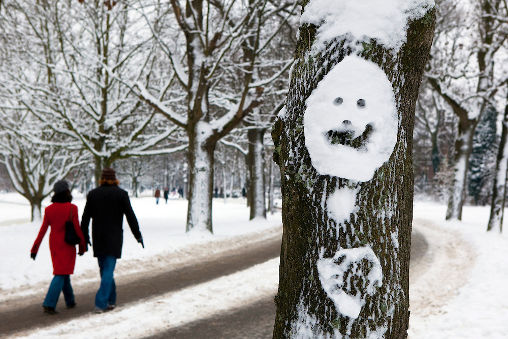 Smiley snow face on a tree in the Vondelpark, Amsterdam