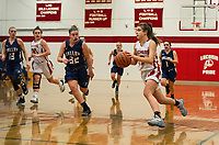 Laconia's Isabella Daly charges downcourt with Merrimack Valley's Abby Grandmaison during NHIAA Division III basketball Wednesday evening.  (Karen Bobotas/for the Laconia Daily Sun)