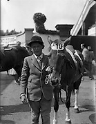 "04/08/1960<br /> 08/04/1960<br /> 04 August 1960<br /> R.D.S Horse Show Dublin (Thursday). Master Norman Aston (aged11) who tied with himself in Competition ""E"" for children over a special course, pictured with his horse ""Bambi""."