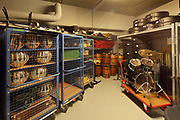 1 of the 6 basement store rooms for musical instruments at the Philarmonie de Paris, or Philharmonie 1, in the Cite de la Musique in the Parc de la Villette in the 19th arrondissement of Paris, France. The collection of 5200 instruments from throughout the world are maintained so they can be used and heard by the public. The building houses a symphony hall by Jean Nouvel, opened in 2015, home of the Orchestre de Paris, and concert halls, exhibition spaces, rehearsal rooms, educational services, restaurant and bars. Picture by Manuel Cohen