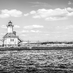 Saint Joseph Michigan Lighthouse panoramic black and white photo. The St. Joseph Lighhouse and pier catwalk are a popular local attraction. The panoramic photo ratio is 1:3.