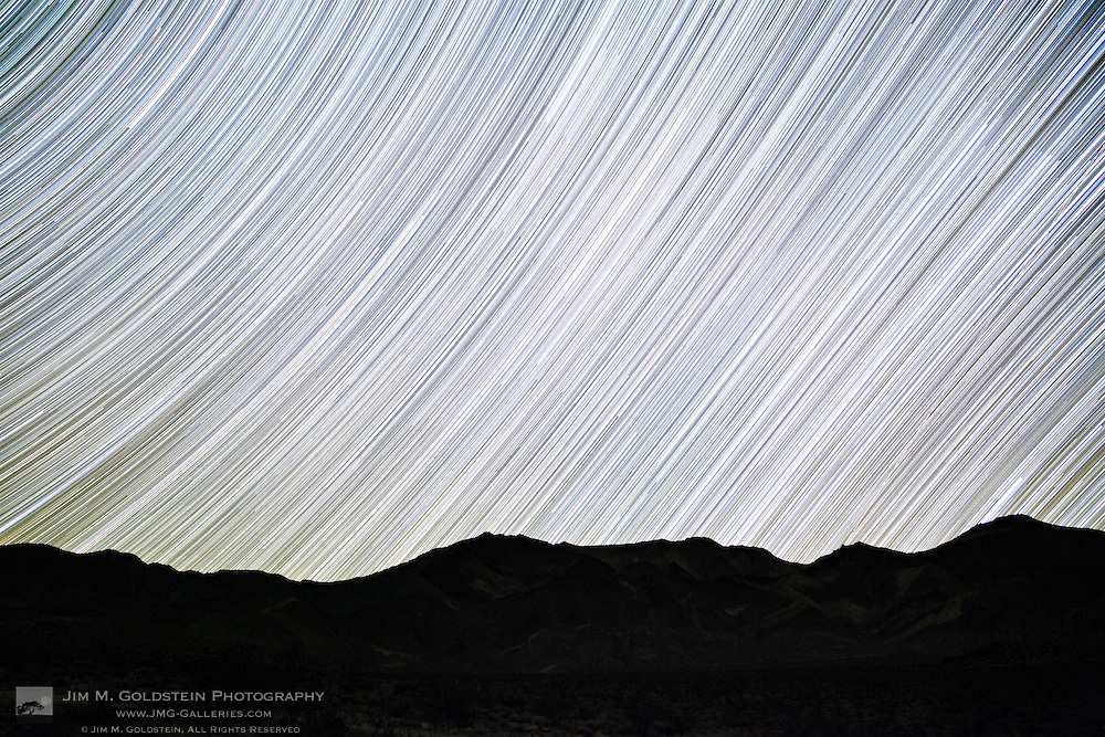 Star trails along the ecliptic plane of the night sky as seen from Death Valley National Park, California