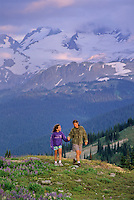 Mom and daughter, 10, walk Whistler Mountain on a summer evening.