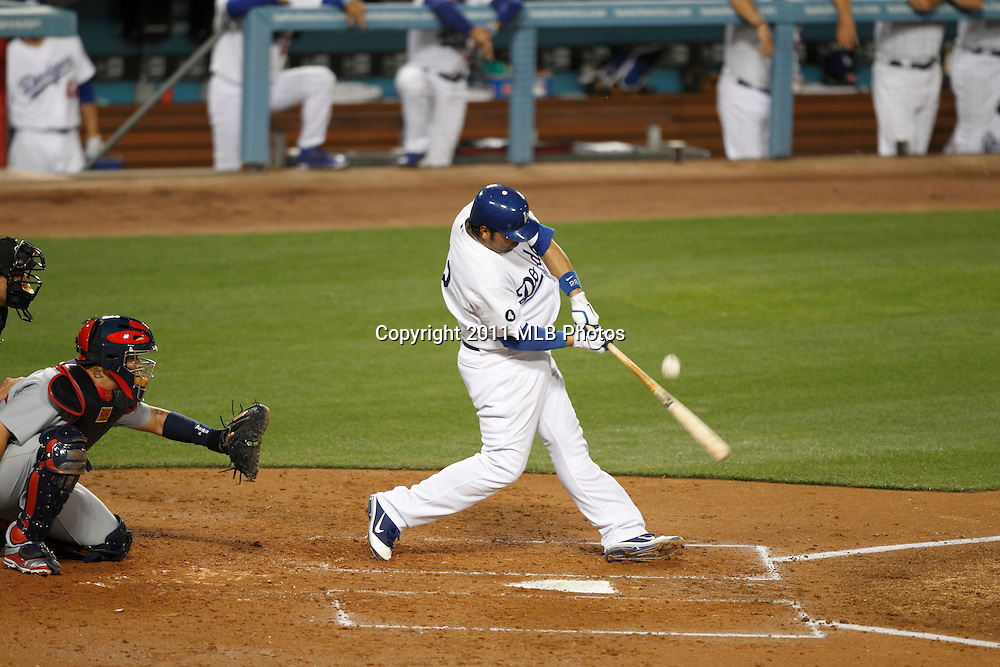 LOS ANGELES, CA - APRIL 15:  Rod Barajas #28 of the Los Angeles Dodgers takes a swing at a pitch during the game between the St. Louis Cardinals and the Los Angeles Dodgers on Friday April 15, 2011 at Dodger Stadium in Los Angeles, California. (Photo by Paul Spinelli/MLB Photos via Getty Images) *** Local Caption *** Rod Barajas