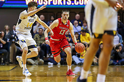 Jan 2, 2019; Morgantown, WV, USA; Texas Tech Red Raiders guard Matt Mooney (13) dribbles during the first half against the West Virginia Mountaineers at WVU Coliseum. Mandatory Credit: Ben Queen-USA TODAY Sports