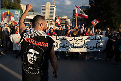 ©2020 Tom Nicholson. 11/01/2020. Beirut, Lebanon. Anti-government demonstrators take part in a protest march from Daoura in east Beirut to Parliament in Downtown Beirut. The demonstrations are part of a wider movement which started in mid October 2019, campaigning against government corruption and economic crisis. Photo credit : Tom Nicholson