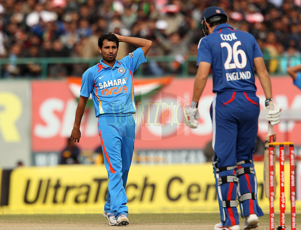 Shami Ahmed of India reacts after bowling to Alastair Cook of England during the 5th Airtel ODI between India and England held at the HPCA Stadium in Dharamsala, Himachal Pradesh, India on the 27th January 2013..Photo by Ron Gaunt/BCCI/SPORTZPICS ..Use of this image is subject to the terms and conditions as outlined by the BCCI. These terms can be found by following this link:..http://www.sportzpics.co.za/image/I0000SoRagM2cIEc