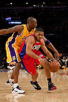 15 January 2010: Guard Eric Gordon of the Los Angeles Clippers dribbles the ball while Kobe Bryant of the Los Angeles Lakers tries to steal it during the first half of the Lakers 126-86 victory over the Clippers at the STAPLES Center in Los Angeles, CA.